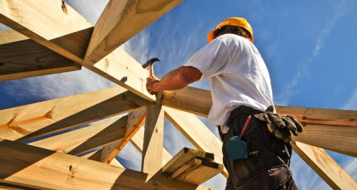 roofer ,carpenter working on roof structure at construction site
